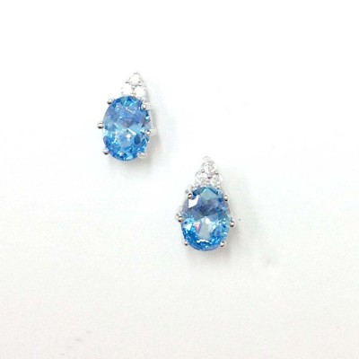 SS Earg 6X8Mm Oval Blue Topaz Cz W 3 Rd Cl Cz Top, Multicolor